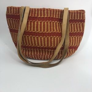 Vintage basket tote bag lined with leather handle